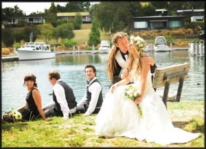 sitting by the wharf in Taupo