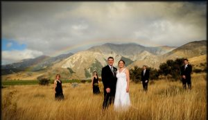 Rainbow wedding on a hill