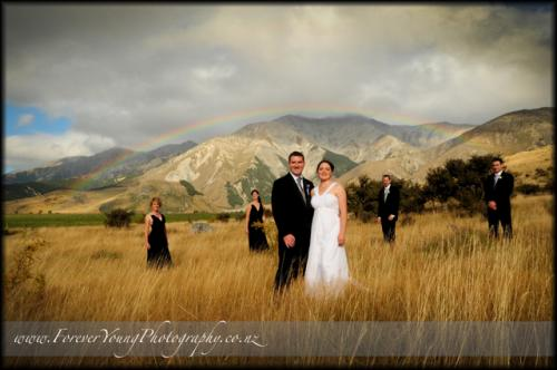 Natalie and Davids wedding with rainbow